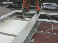 The first layer of foam is applied to the steel floor